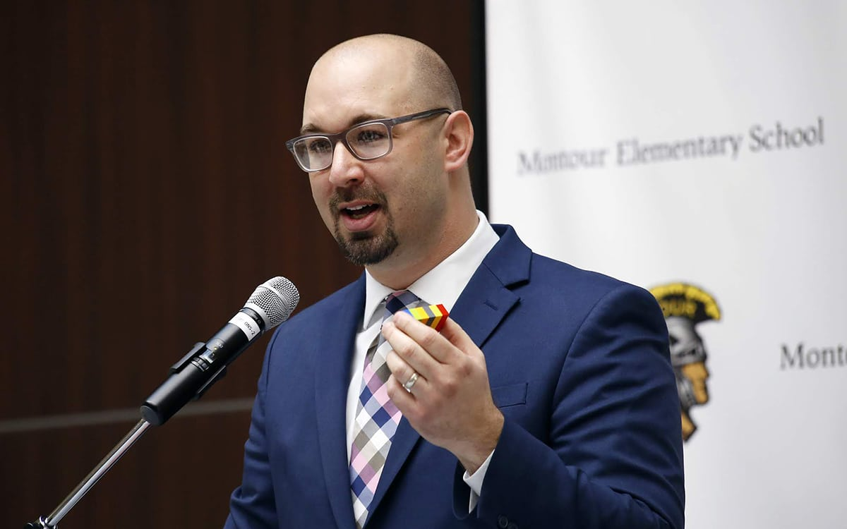 Justin Aglio, Montour's director of academic achievement K-4 and district innovation, holds Legos as he speaks prior to the grand opening of the Brick Makerspace, a room filled with Legos and other building materials and equipment at the new Montour Elementary.