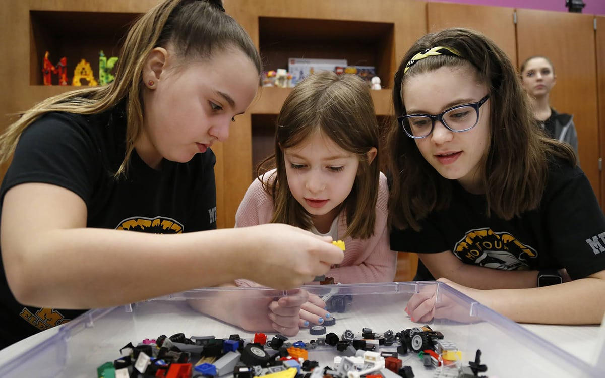 Inside the Brick Makerspace—a room filled with Legos and other building materials and equipment at Montour Elementary—students Joslin Heckathorne (left), Emma Mcmahon (center) and Brynn Kaczmarek build a car with Legos on Feb. 22, 2018.