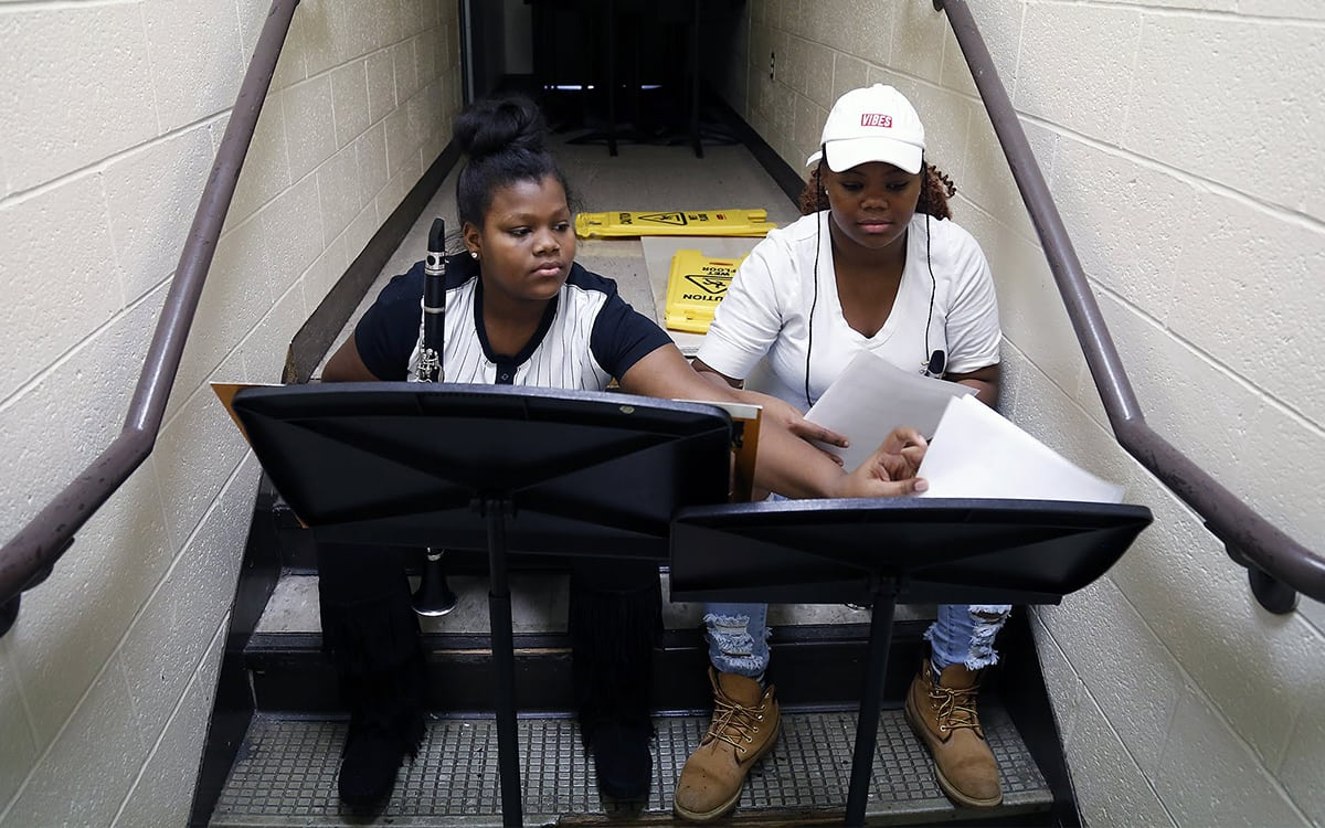 In December 2017, Sto-Rox Junior-Senior High School students Alayha Lee Rice (left) and Asia Johnson practice playing clarinet in a hallway during band class.