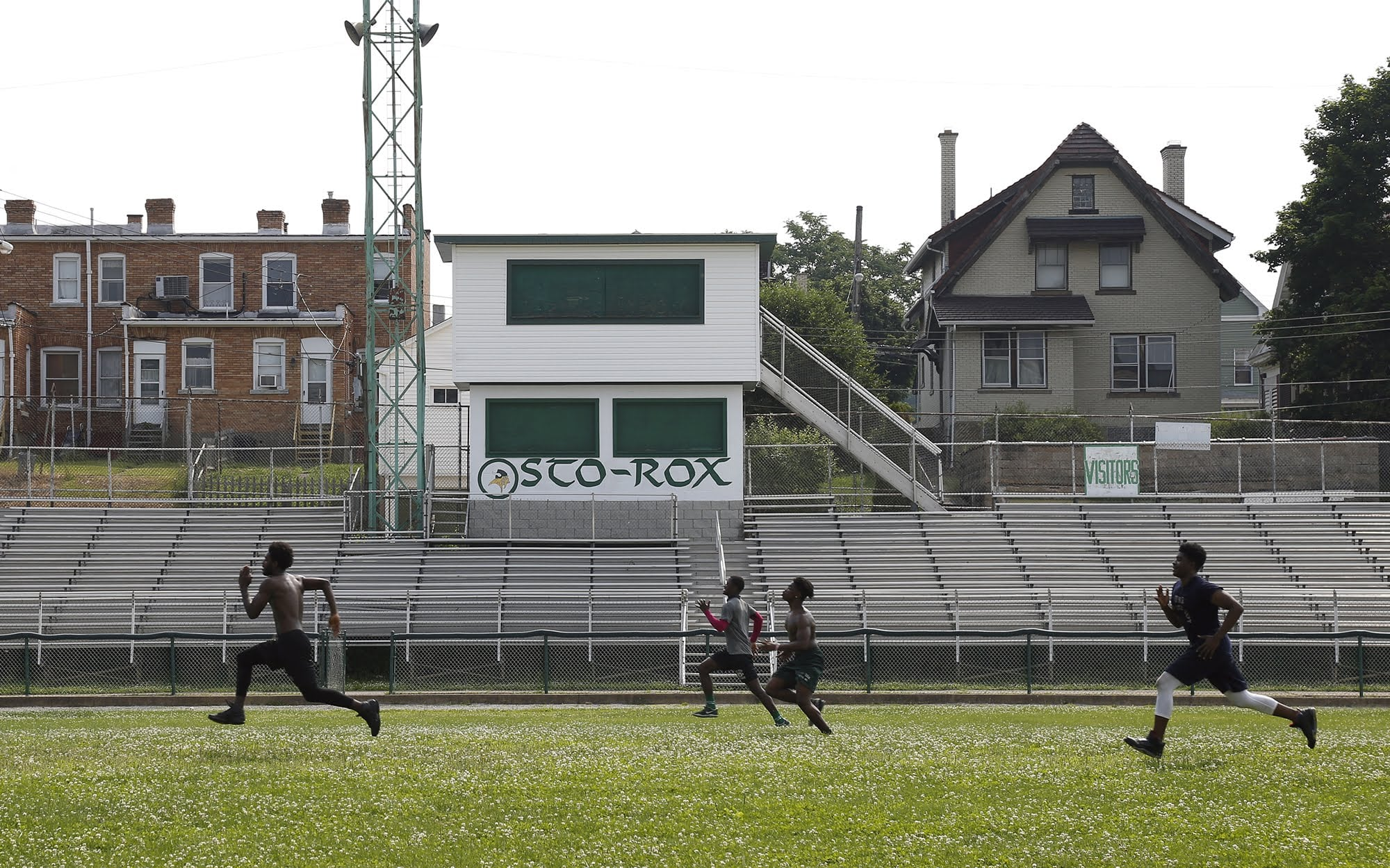 Members of the Sto-Rox football team run across the school's football field in June.