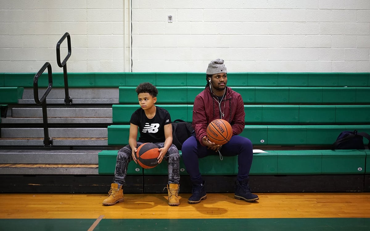 In December 2017, Sto-Rox Junior-Senior High School students Tyson Peterson (left) and Will Johnson watch as fellow students play basketball.