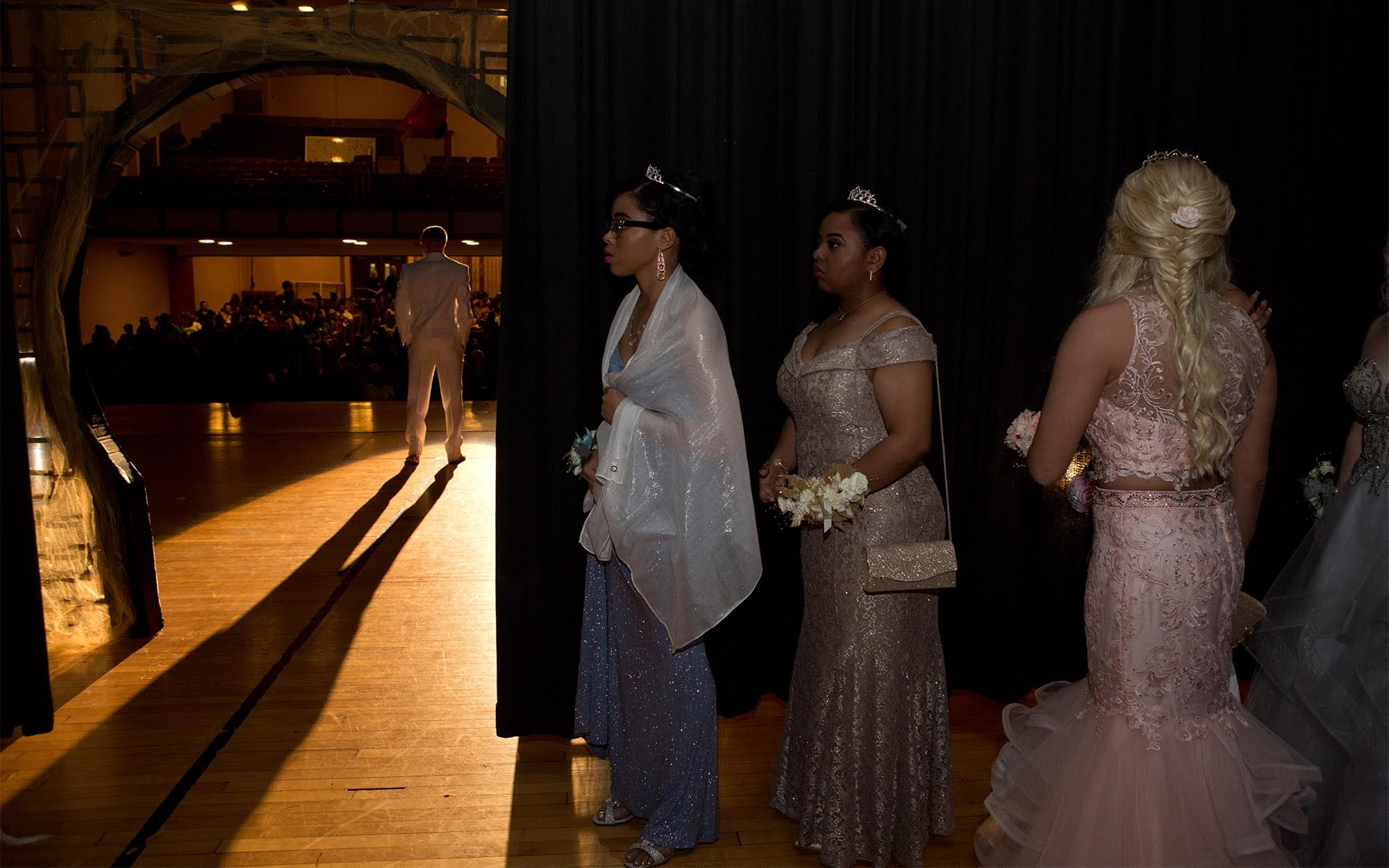 Candidates for prom queen await introduction backstage during the 2018 Clairton Promenade. (Photo by Heather Mull/PublicSource)