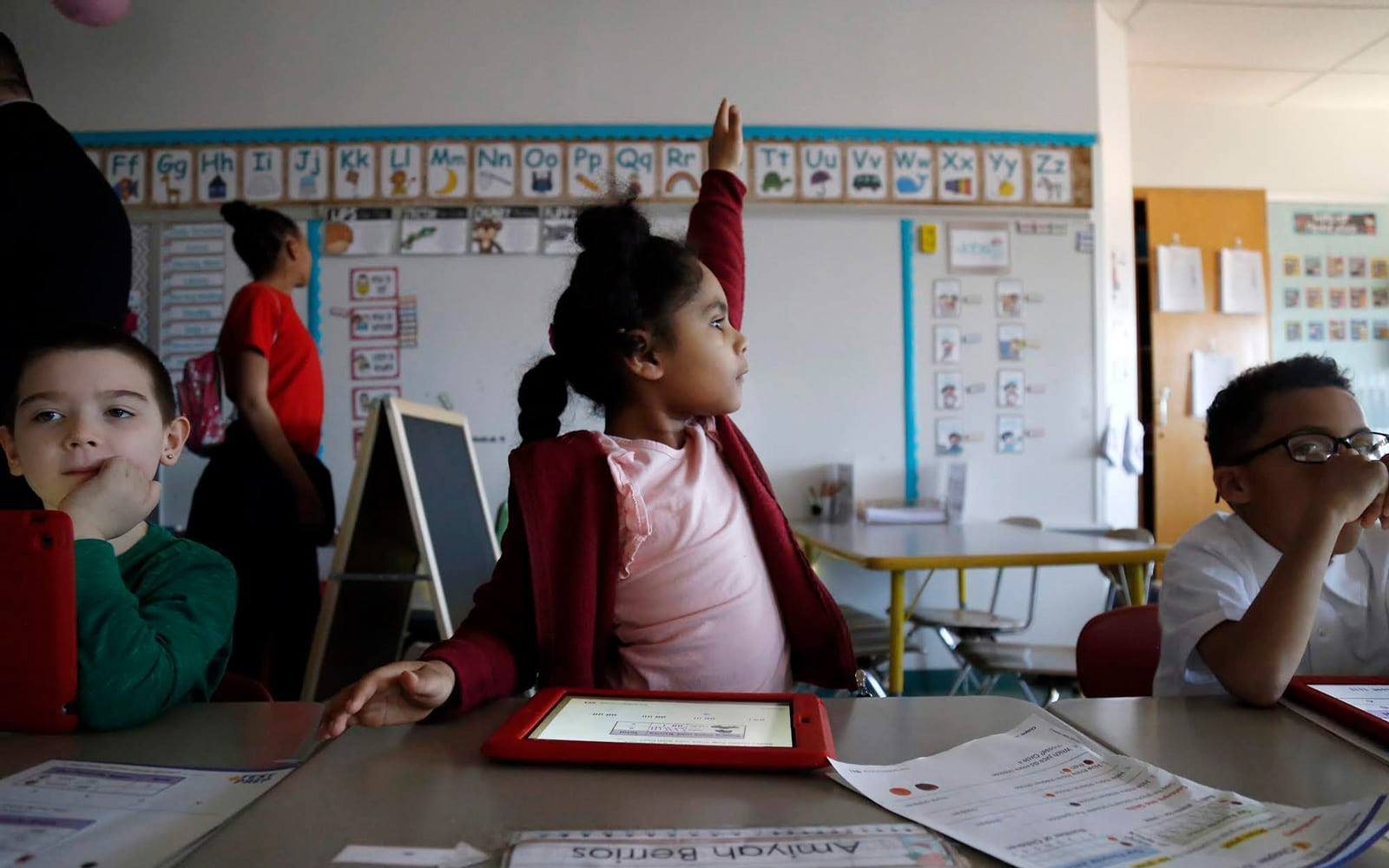 In March, Amiyah Berrios, then a first-grade student at Duquesne Elementary School, raises her hand during math class.