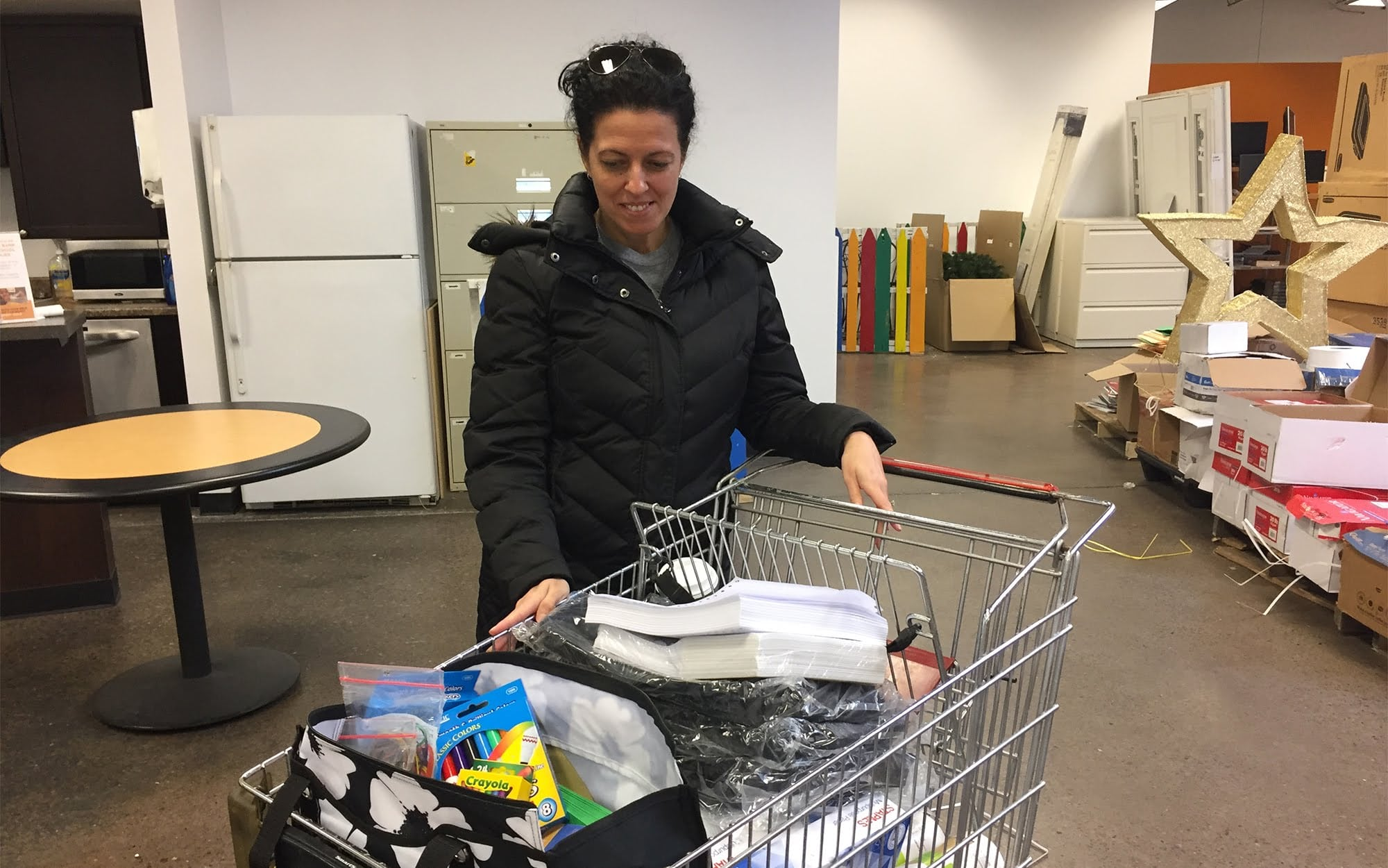 Sherri Koger, a second-grade teacher at Sto-Rox Primary Center, leaves The Education Partnership distribution on March 10 with a cart full of supplies for her students.