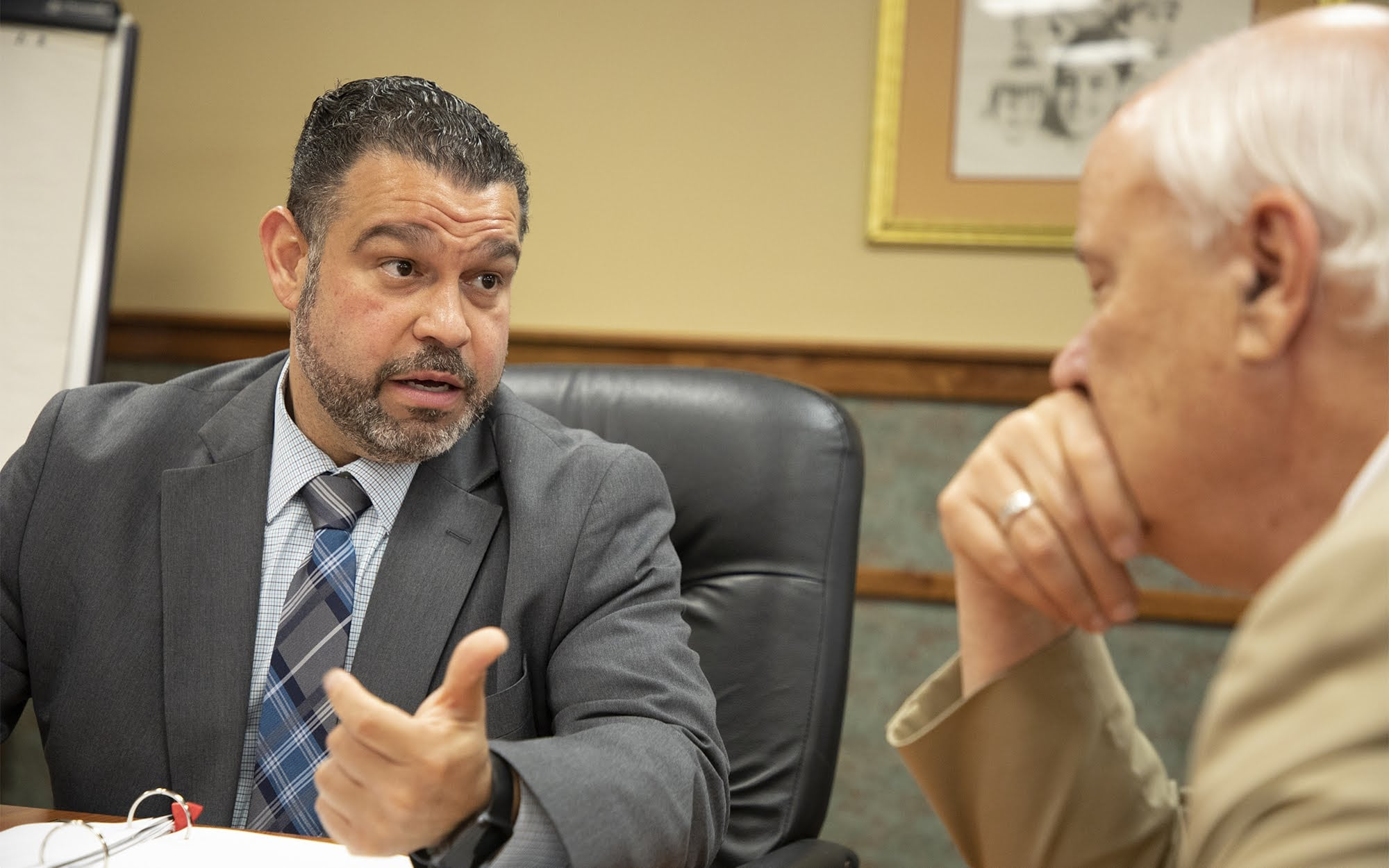Pennsylvania Secretary of Education Pedro A. Rivera speaks with the executive director of Intermediate Unit I, Charles F. Mahoney III, at its headquarters in Coal Center, Pa., on June 12, 2018.