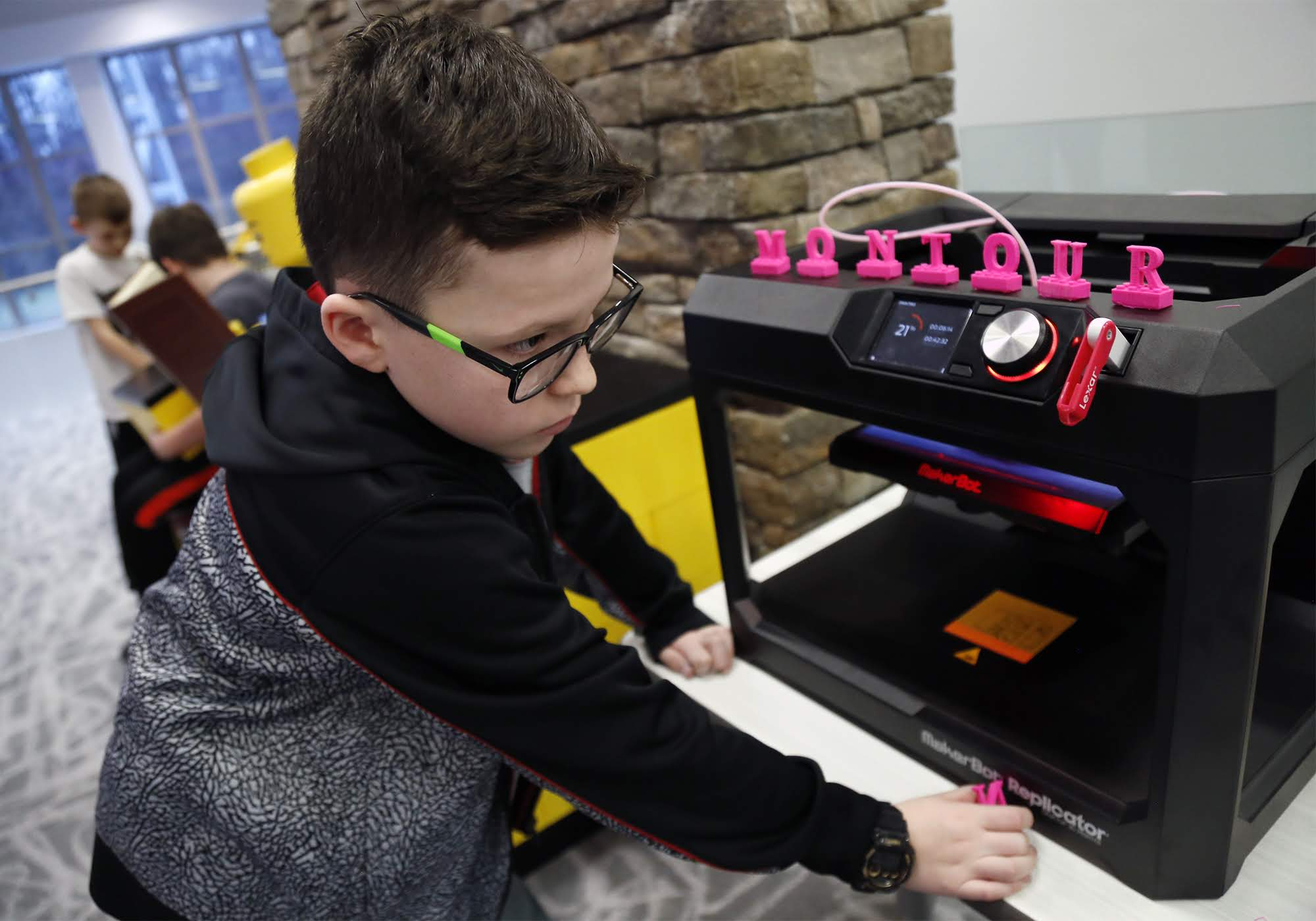 Braden Cartwright checks out a 3D printer inside the Brick Makerspace, a room filled with Legos and other building materials and equipment at Montour Elementary on Feb. 22, 2018.