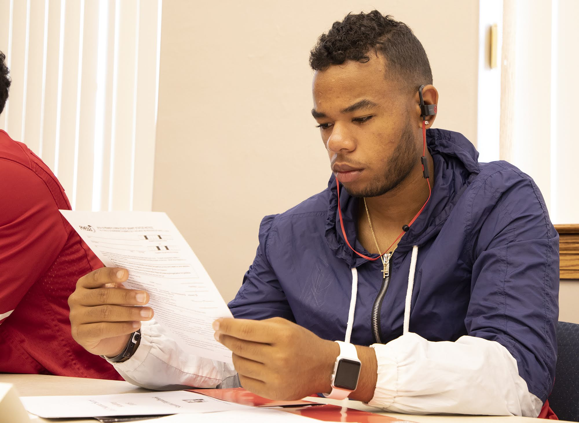 Brycen Simpson, 20, of New Kensington, looks over paperwork from the Pennsylvania Higher Education Assistance Agency during the Summer Success Academy at California University of Pennsylvania on Aug. 14, 2018.