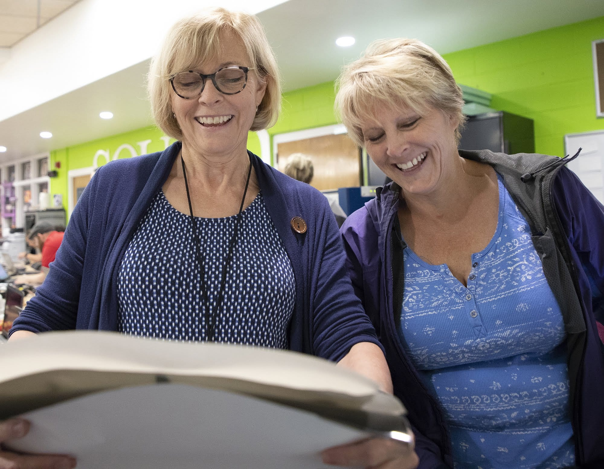 Sally Kunkel, a teacher at the Clairton School District, laughs with her sister, Wendy Pasternack, also a teacher at the Elizabeth Forward School District, after feeding paper into the vinyl cutter at the FAB Institute at Elizabeth Forward High School on June 21.