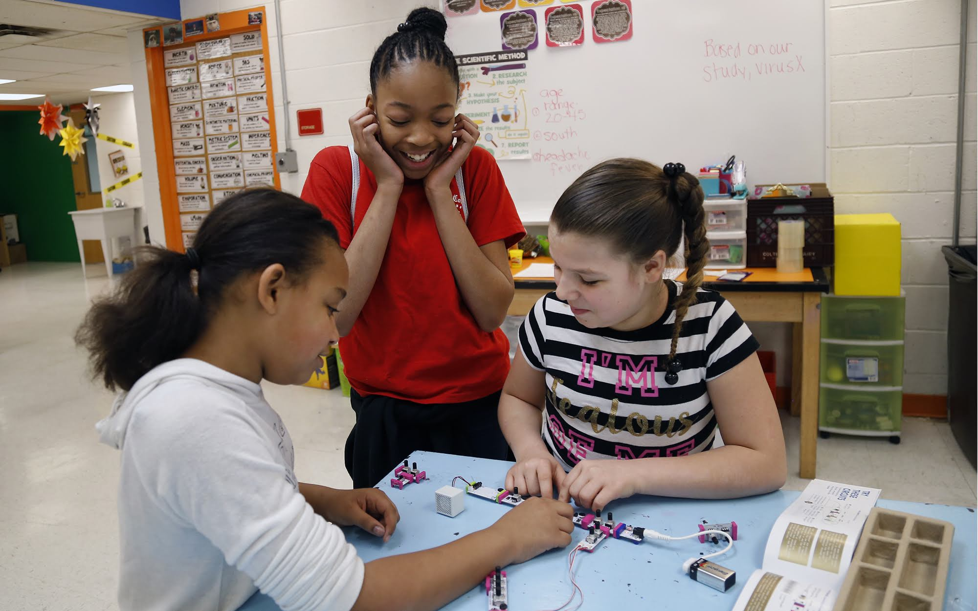 Duquesne Elementary School students Raniyah Hall, Amya Gates and Lillian Dainty (left to right) use connectable circuits called littleBits to experiment with sound frequencies in the school's Boiler Room on March 26.