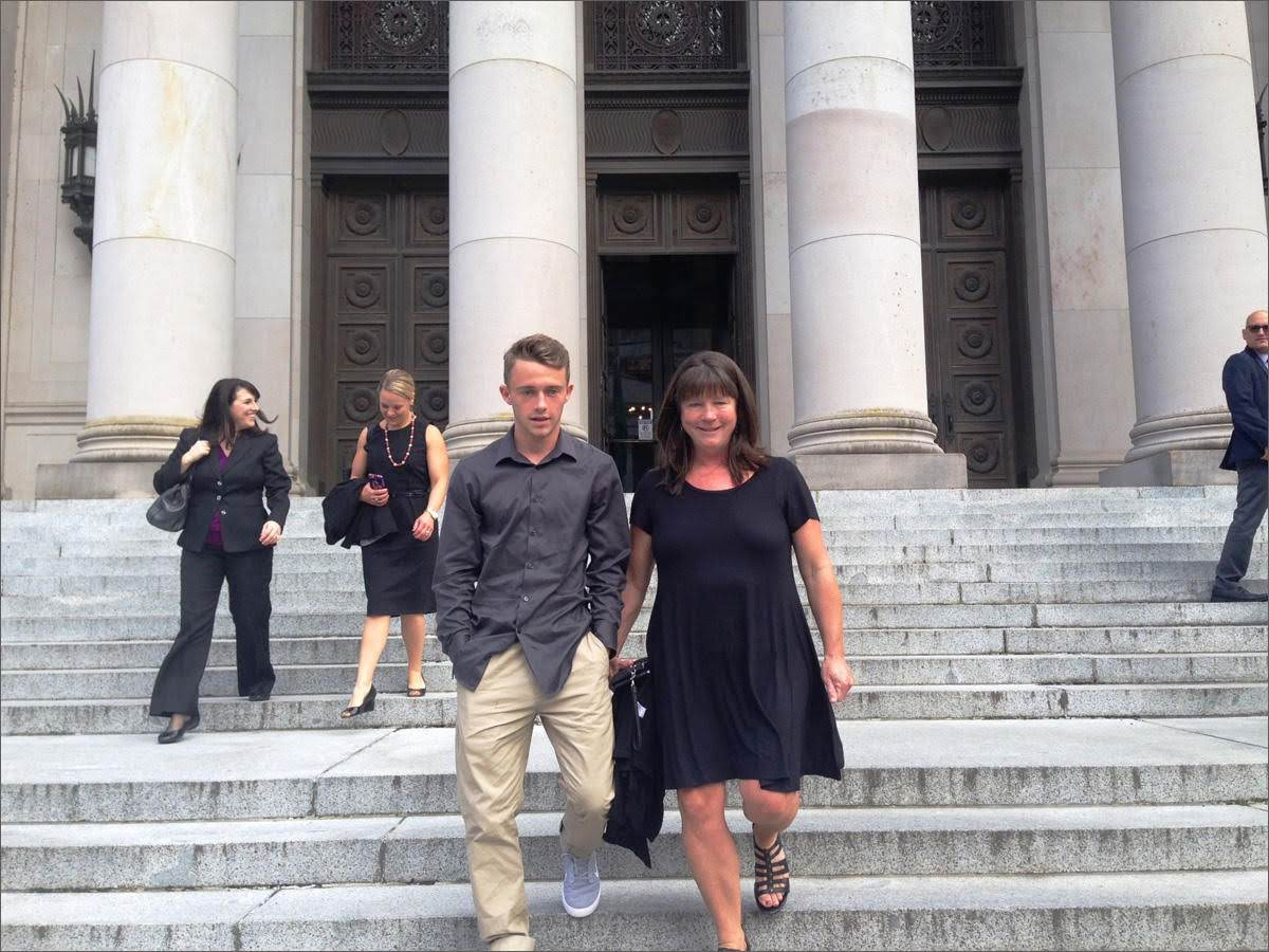 In this 2016 photo, Stephanie McCleary and her son, Carter, leave the Washington Supreme Court following a hearing in the nearly decade-old school funding lawsuit that bears their name. (Photo by Austin Jenkins/Northwest News Network)